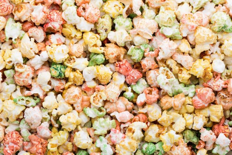 Fondo coloreado de la textura de las palomitas Palomitas dulces imagen de archivo libre de regalías