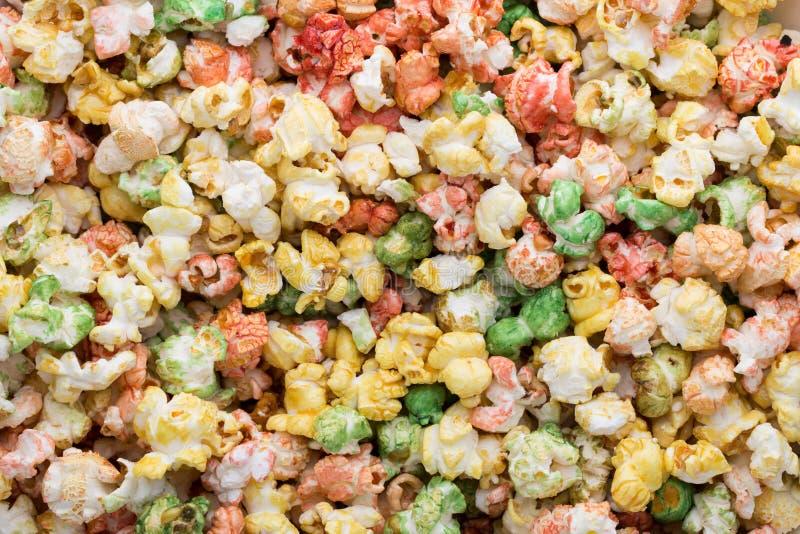 Fondo coloreado de la textura de las palomitas Palomitas dulces fotografía de archivo libre de regalías