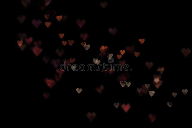 Fondo colorido de los corazones del bokeh fotografía de archivo