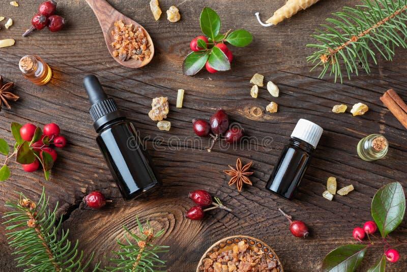 Fondo con aceites esenciales, mirra, incienso, w de la Navidad imagen de archivo