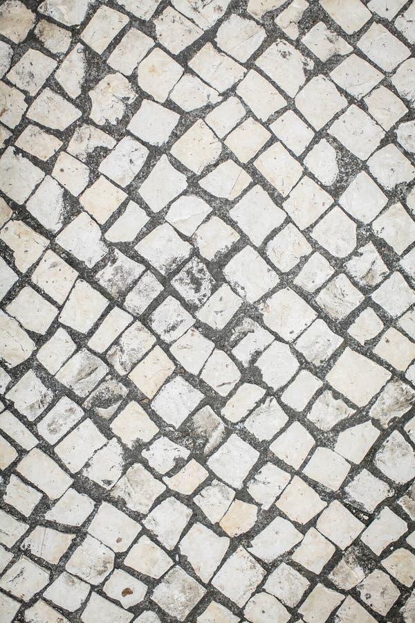 Fondo con el modelo de la vieja opinión superior de la piedra de pavimentación imagen de archivo libre de regalías