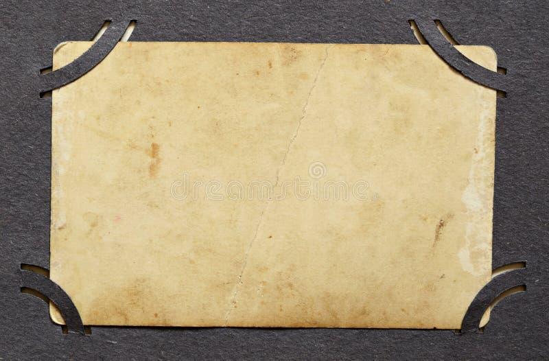 Contexto de la foto vieja en un álbum imágenes de archivo libres de regalías