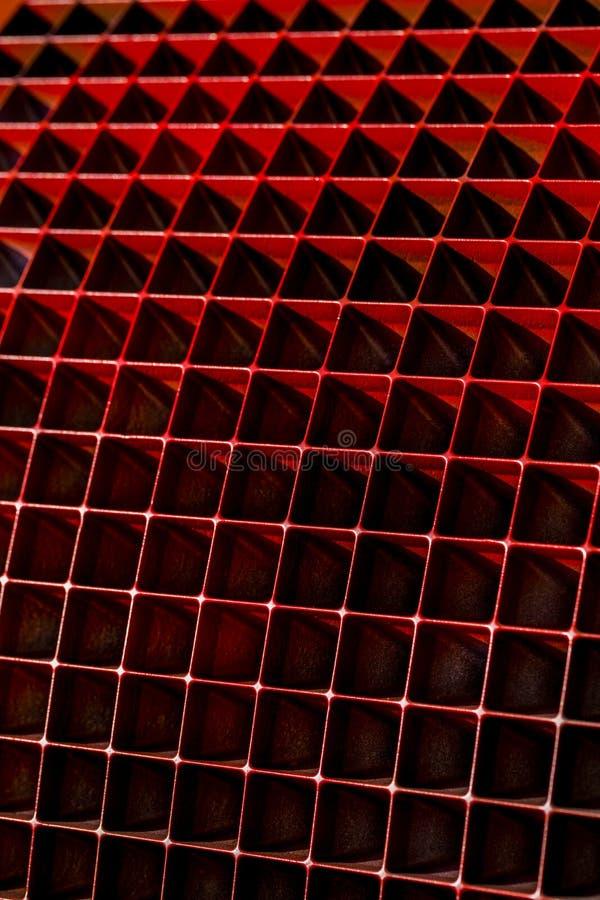 Fondo con le forme geometriche di forma astratta nel rosso fotografie stock libere da diritti