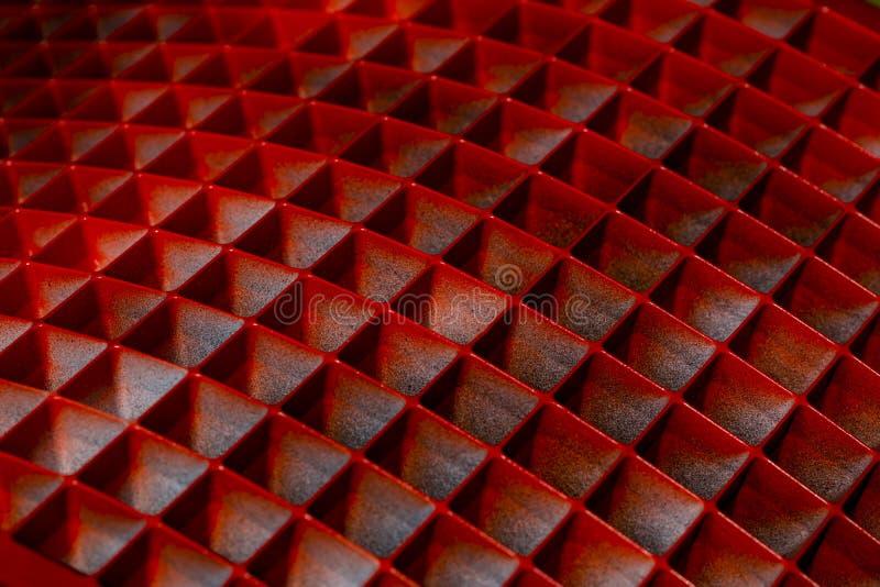 Fondo con le forme geometriche di forma astratta nel rosso fotografia stock