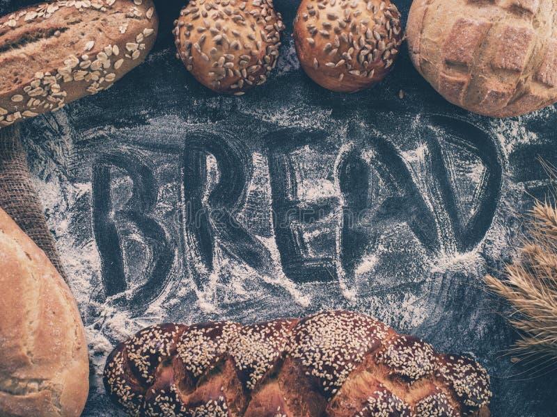 Fondo con pan fresco y la inscripción fotografía de archivo libre de regalías