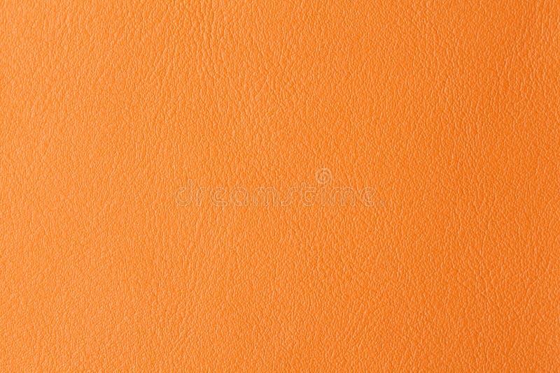 Fondo con textura del cuero anaranjado foto de archivo