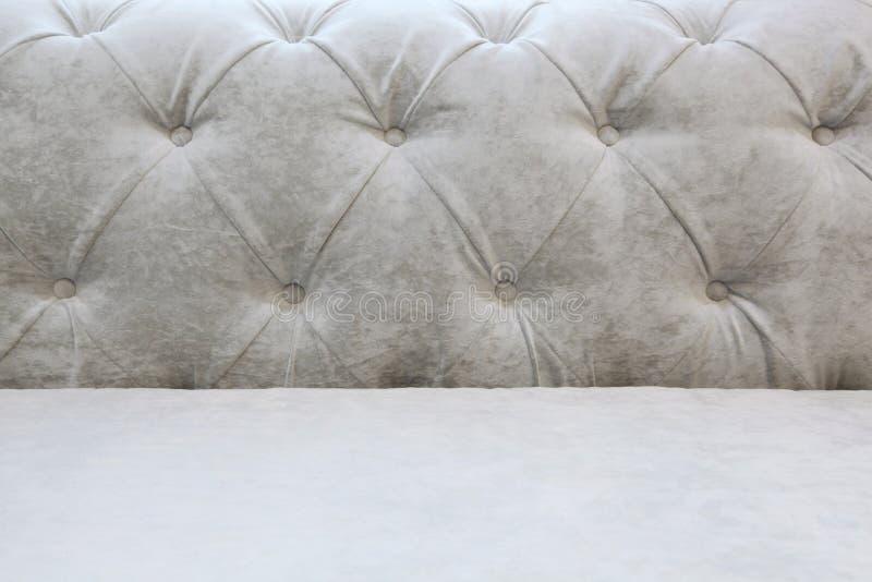 Fondo con una parte posterior y un asiento de un sofá ligero - perorata del carro fotos de archivo libres de regalías