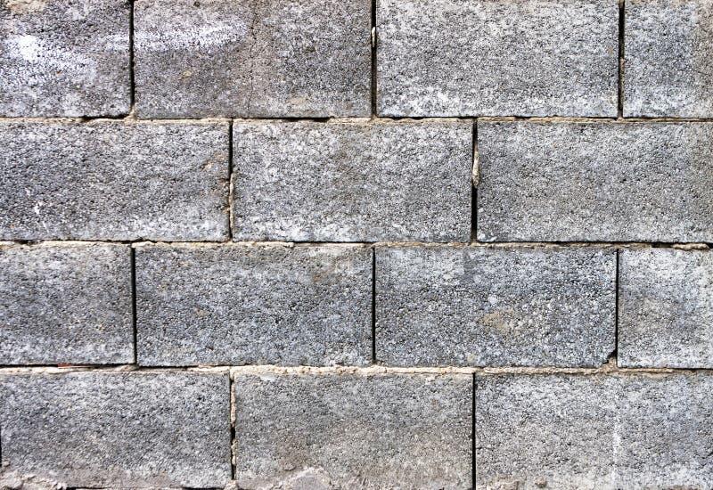 Fondo concreto grigio del muro di mattoni immagini stock libere da diritti