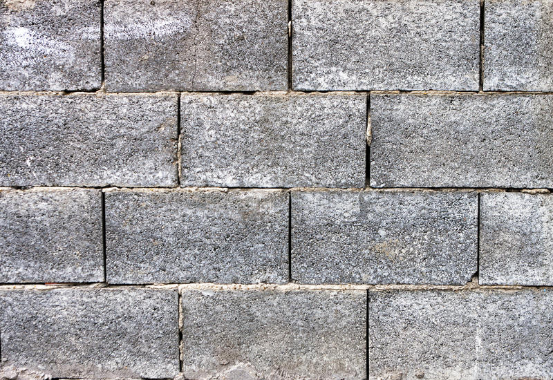 Fondo concreto gris de la pared de ladrillo imágenes de archivo libres de regalías