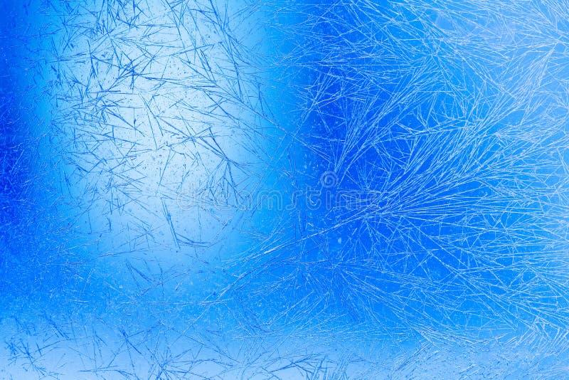 Fondo congelado de la Navidad de la ventana Las flores del hielo texturizaron la opinión macra del modelo Profundidad del campo b fotos de archivo libres de regalías