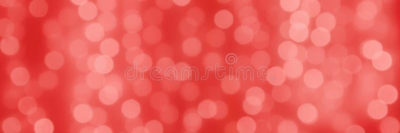 Fondo coralino del día de fiesta de Abstact con las bolas ligeras del bokeh foto de archivo