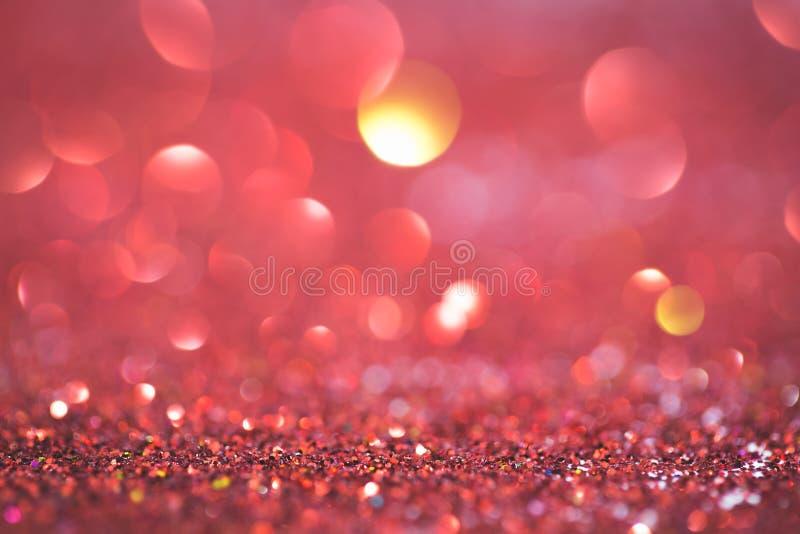 Fondo coralino rojo de la celebración de días festivos del bokeh de la luz del brillo del extracto fotografía de archivo libre de regalías