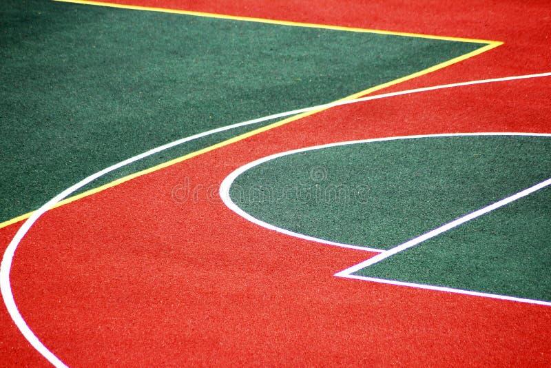 Fondo corriente de la textura de la pista, estadio verde rojo imagenes de archivo