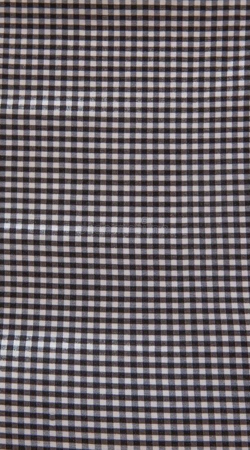 Fondo a cuadros gris y blanco de la textura de la tela fotografía de archivo
