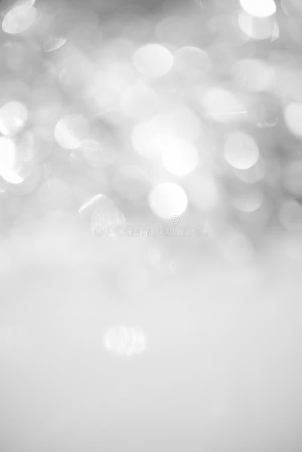 Fondo d'argento astratto Unfocused di festa di scintillio fotografia stock