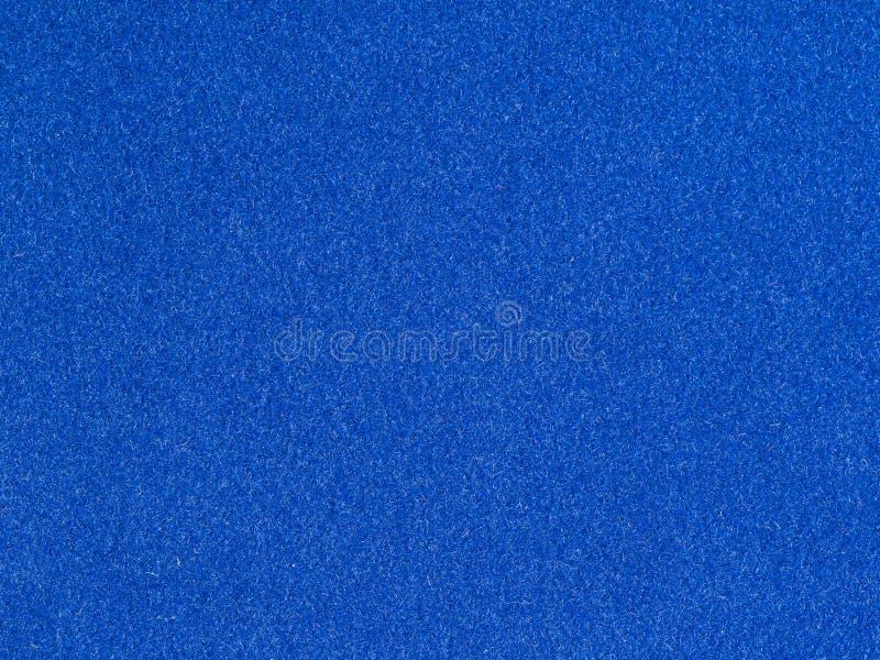 fondo dalla carta da parati ruvida blu del velluto fotografia stock