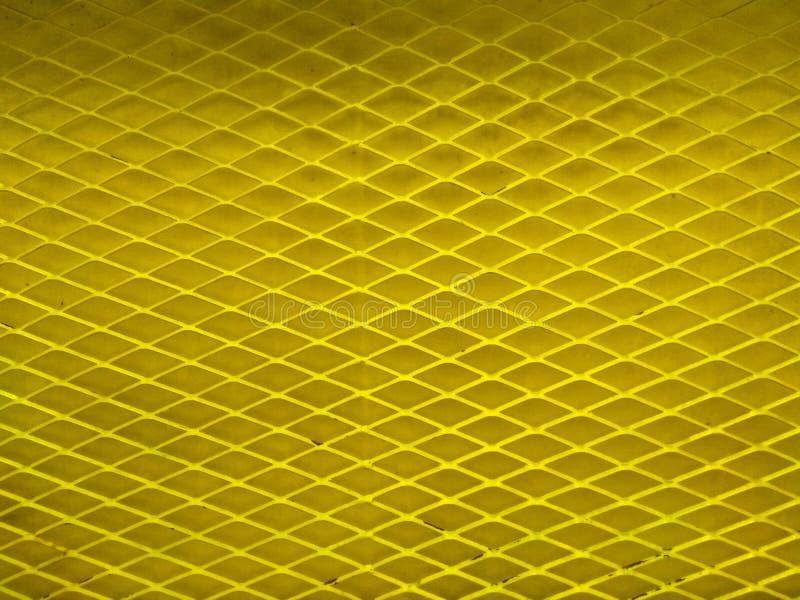 Fondo de cercado amarillo del modelo del alambre fotografía de archivo libre de regalías