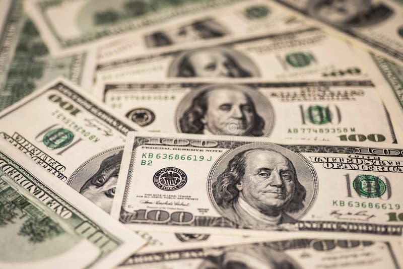 Fondo de cientos billetes de dólar foto de archivo