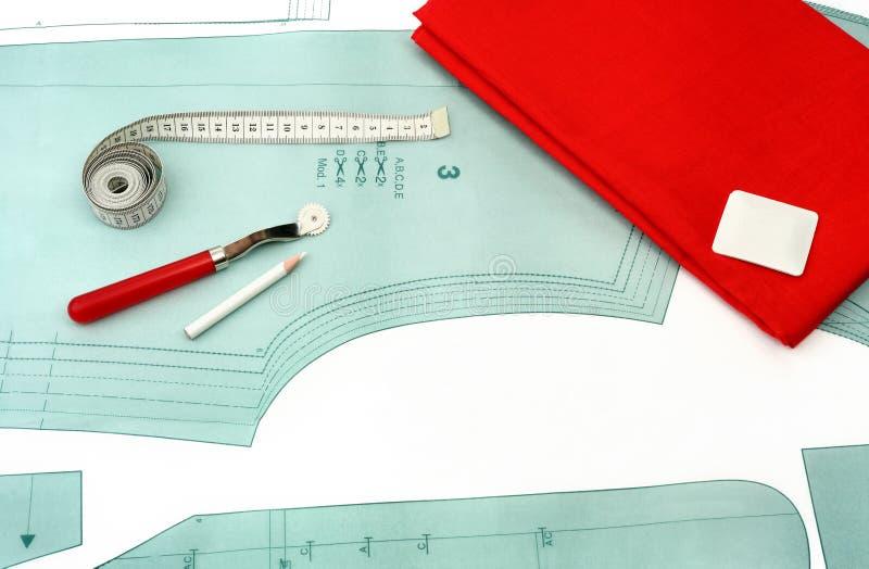 Fondo de costura Accesorios y tela de costura en un modelo de papel imagen de archivo