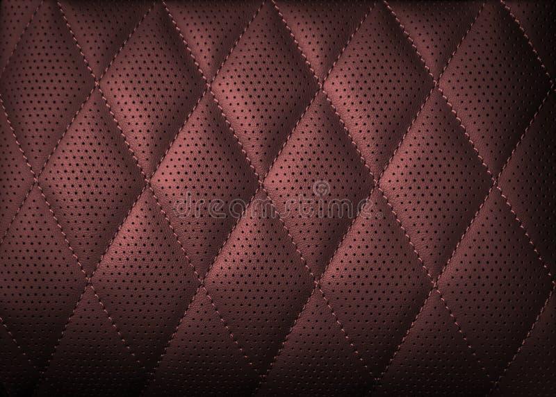 Fondo de cuero perforado de la textura para el diseño, rojo oscuro ilustración del vector