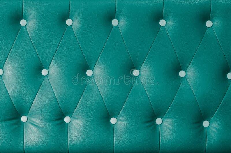 Fondo de cuero verde del sofá imágenes de archivo libres de regalías