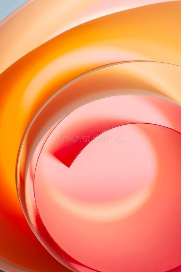 Fondo de elementos redondeados multicolores en rosa y colores anaranjados fotos de archivo libres de regalías