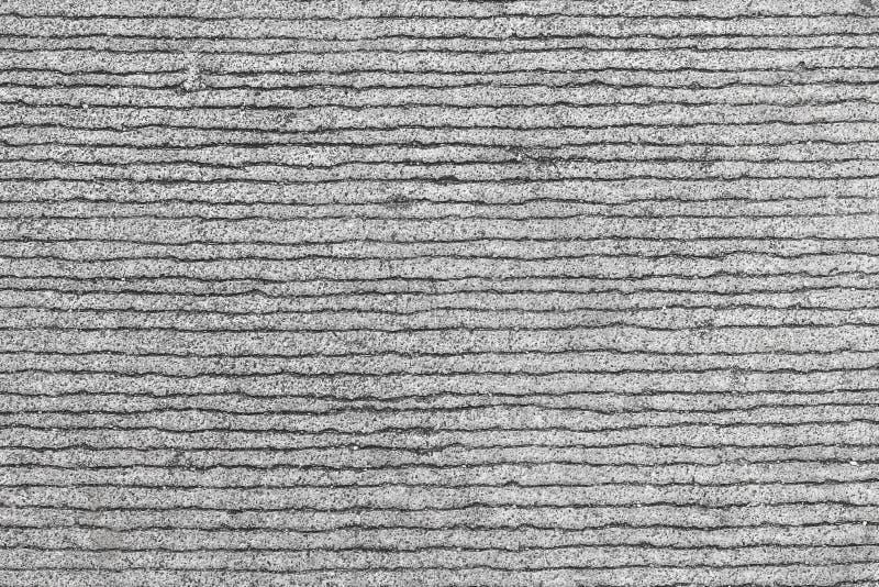 Fondo de líneas ásperas en los caminos concretos viejos imagenes de archivo