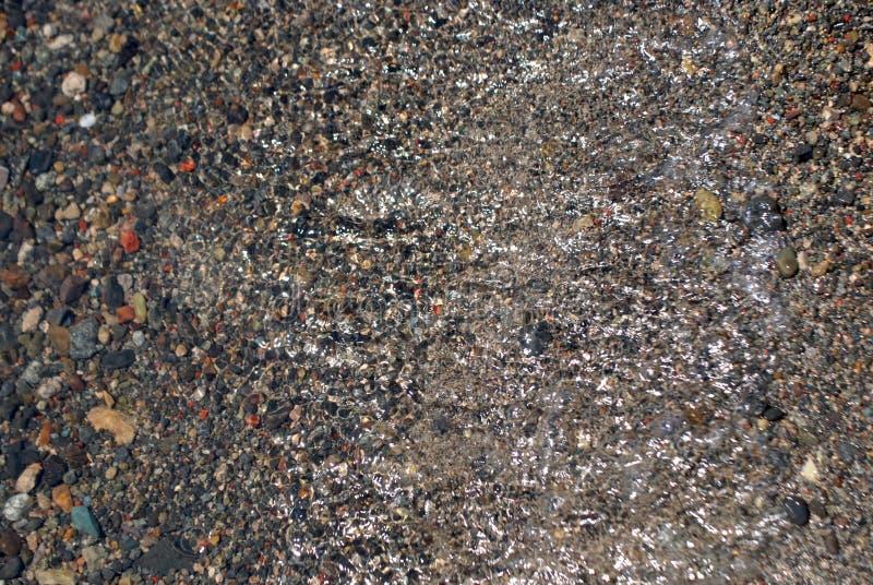 Fondo de la arena, de la piedra y del agua imágenes de archivo libres de regalías