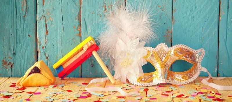 Fondo de la bandera del sitio web del concepto de la celebración de Purim (día de fiesta judío del carnaval) Foco selectivo Vinta foto de archivo libre de regalías