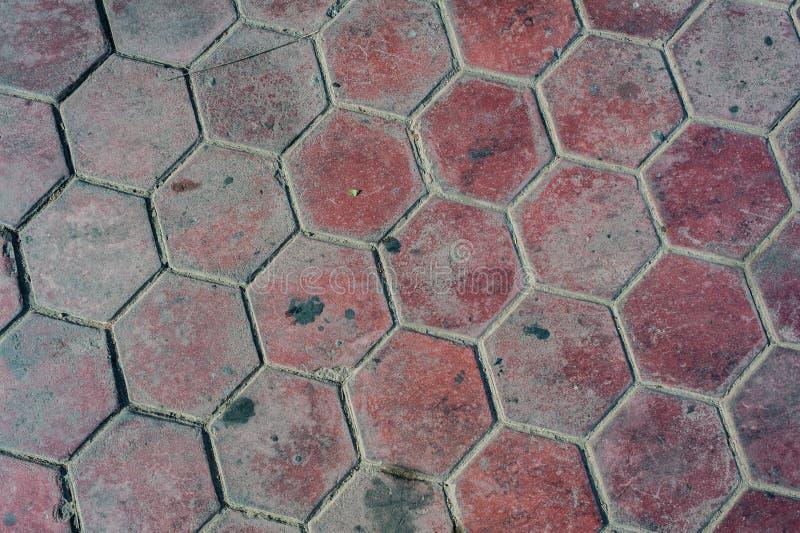 Fondo de la calle Cobblestone. El color rojo marrón bloquea la textura al aire libre foto de archivo