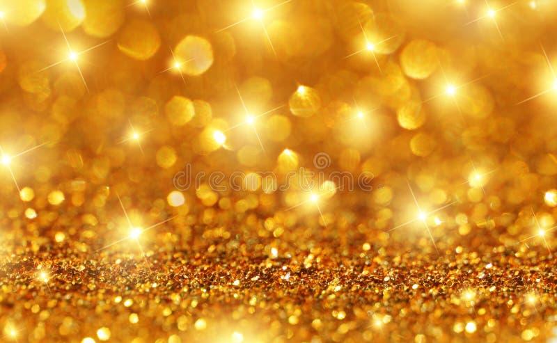 Fondo de la chispa del oro foto de archivo