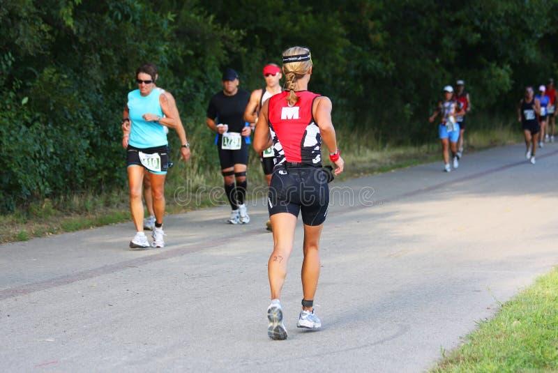 Fondo de la competencia del triathlon de Ironman fotos de archivo libres de regalías