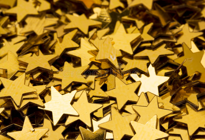 Fondo de la estrella del oro fotos de archivo
