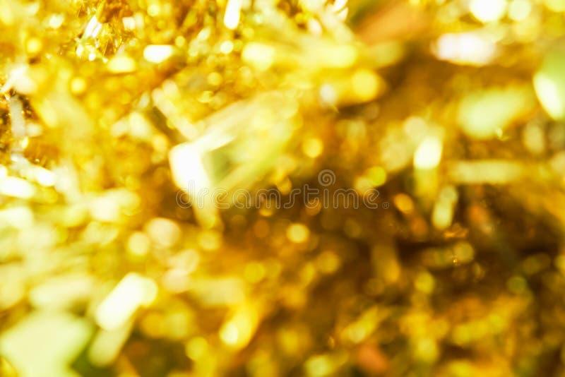 Fondo de la falta de definición de la luz del bokeh del color oro fotografía de archivo