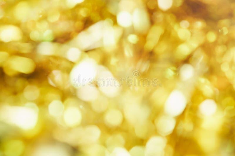 Fondo de la falta de definición de la luz del bokeh del color oro fotos de archivo libres de regalías