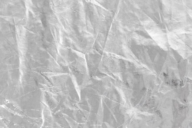 Fondo de la hoja de plata con la superficie desigual arrugada brillante para el te fotografía de archivo libre de regalías