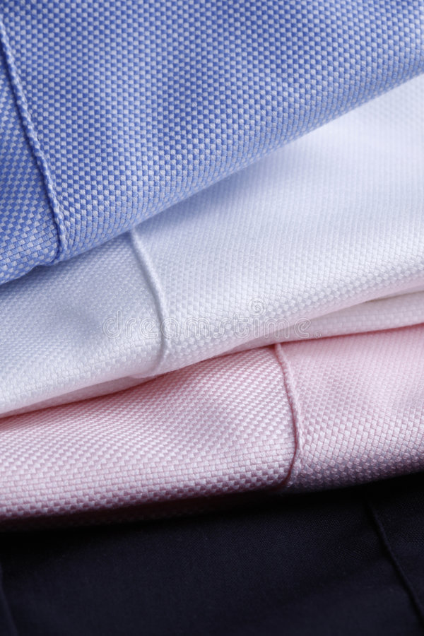 Fondo de la materia textil - tres camisas imagenes de archivo