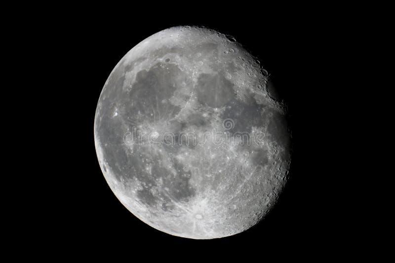 Fondo de la media luna, satélite natural giboso del ` s de la tierra de la luna imagenes de archivo
