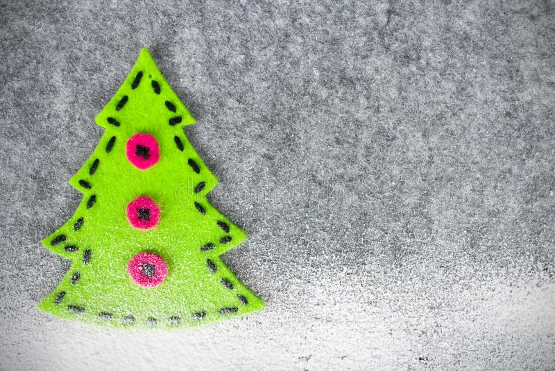 Fondo de la Navidad con la decoración del fieltro: Árbol de navidad fotos de archivo libres de regalías