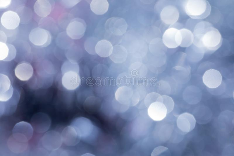 Fondo de la Navidad con las luces de la falta de definición imagen de archivo libre de regalías