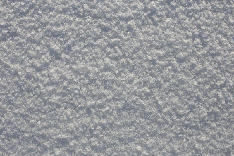 Fondo de la nieve en un día soleado foto de archivo