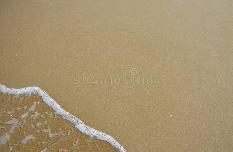 Fondo de la onda y de la arena fotografía de archivo libre de regalías