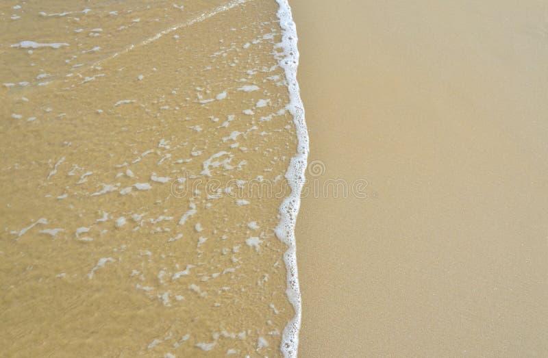 Fondo de la onda y de la arena imagen de archivo