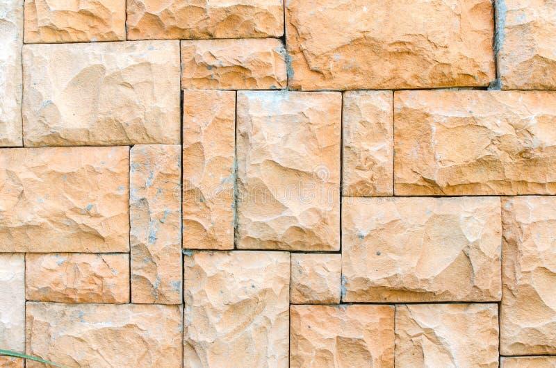 Fondo de la pared de piedra hecho con los bloques fotografía de archivo