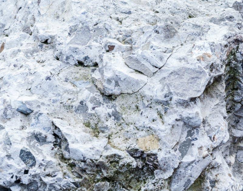 Fondo de la pared del yeso y estilo de piedra concretos agrietados envejecidos de la textura imagenes de archivo