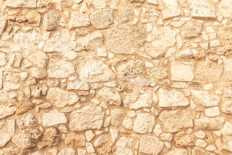 Fondo de la pared de ladrillo antigua Textura de la piedra vieja del anfiteatro Textura de una pared de ladrillo antigua hecha de fotografía de archivo libre de regalías