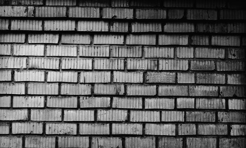 Fondo de la pared de ladrillo vieja, textura gris de la albañilería fotografía de archivo