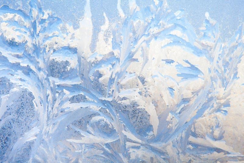 Fondo de la pintura en la ventana congelada por helada - nadie imagenes de archivo