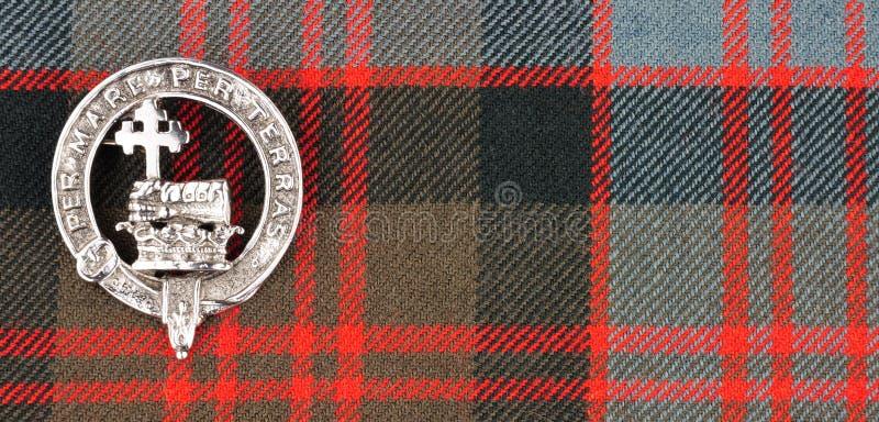 Fondo de la tela del tartán de MacDonald Clan Family Crest On del escocés fotografía de archivo libre de regalías
