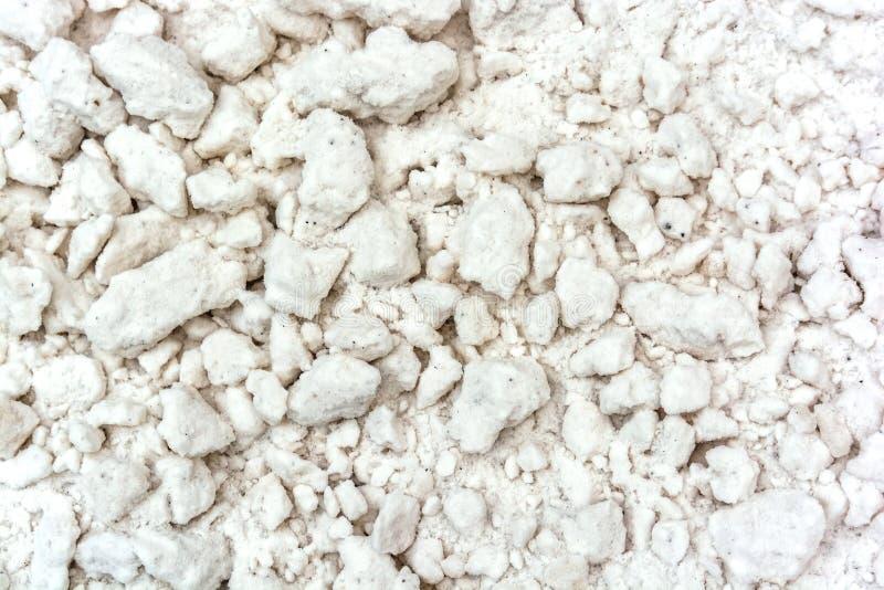 Fondo de la textura de la nieve con los terrones de la nieve fotografía de archivo